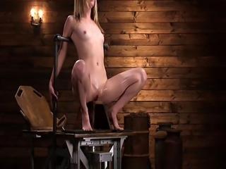 Babe rides fucking machine chair