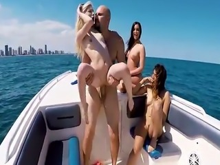 Wild bikini babes in a hot boat party orgy
