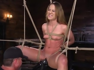 Cheyenne is tied up really nice here, and her pussy is getting an unrelenting bit of attention from her executor. Legs spread wide, she cannot stop the dildo on a stick from being shoved inside her, nor the powerful vibrator pressed against her afterward.