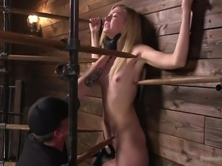 The master had this hot blonde tied up and held against the wall. He gets really rough with her, as he pokes her and plays with her dripping wet pussy. He won't let her go until he is satisfied. The master is in control.