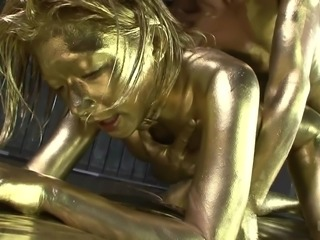 This horny Japanese couple has a fetish for luxury and fancy things. She lies on her side and her man enters her wet vagina. They are shining bright because both of these weirdos are completely covered in gold paint, which heightens their sexual experience.