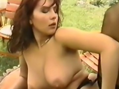 Impeccable and busty redhead babe in the garden having wild sex