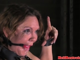 Busty dominated submissive gagging in bdsm