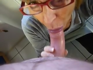 My nerdy wife in glasses sucks dick obediently