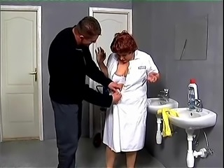 Redhead mature woman gets nailed by a muscled guy