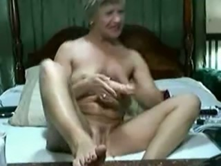 Dirty granny with saggy boobs poking her vagina with big sex toy