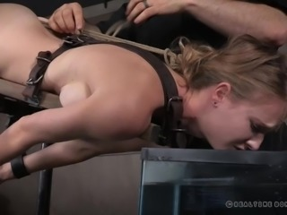 Beautiful babe Ashley feels a mixture of fear and anticipation, as she dives deeper into the world of BDSM. Bound tightly in leather straps, watch her struggle and gasp for breath, as her head is submerged repeatedly into an aquarium filled with water.