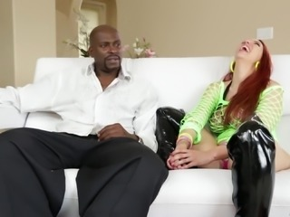 Redhead girl in fishnet and leather chats nasty dude in interracial backstage clip