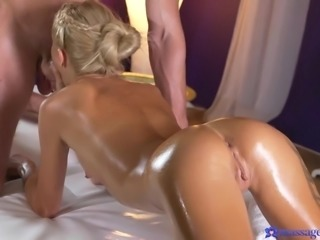 Blonde goddess Katrin made an appointment at the spa for a massage, but horny masseur Max had more than just that planned for her. Instead of relaxing her, his talented hands woke her lust to a fever pitch, until she was taking his hard cock into her mouth, then getting drilled from behind.