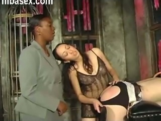 My slave's ass is fully exposed to me and I can spank it hard