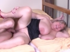 Granny with massive tits treats a fellow to a sex session