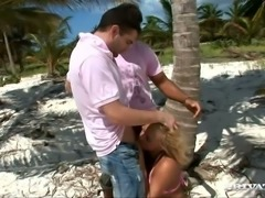 Outdoorsy babe Britney ends up getting fucked by two men on the beach