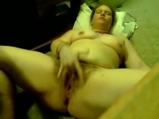 My chubby girlfriend is pleasing herself on the floor