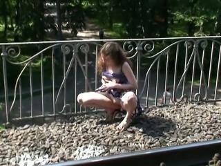 Redhead pale skin Russian teen on the bridge shows her goodies