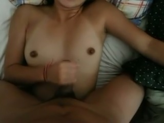 Charming Asian girlfriend stroking my dick intensively