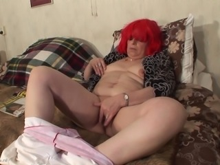 Redhead Coosje comfortable masturbating using toy in mature scene