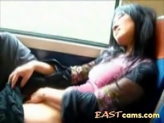 Asian milf masturbates pussy in the train