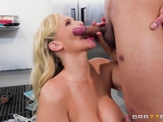 Julia Ann receives a tasty wiener in her face and restless pussy