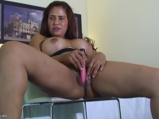 Curvy woman Alicia B bends over for a masturbation game