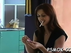 Tempting chick popping balloons with her cigarette