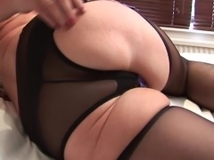 Claire K spreads her legs in stockings for a solo sex session