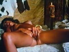 Sexy and sassy vintage ebony babe riding on a white cock