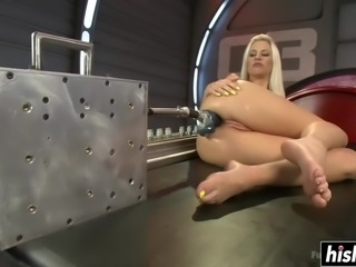 Hot blonde babe gets her cunt penetrated by a machine with two dildos