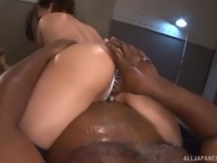 Oiled up chick Mako Oda enjoys being fucked by a black man