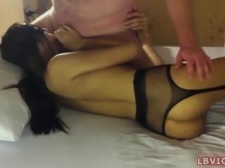 Ladyboy Pamela wears kinky crotchless pantyhose and fetish mask.