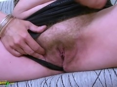 Hot mature lady is playing alone masturbating with her sex toy
