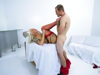 Naughty transsexual nurse Aubrey Kate spreds her legs for a boner