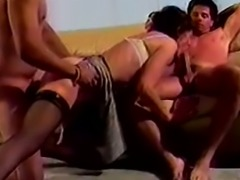 Insatiable lean brunette cougar enjoys hardcore FMM threesome