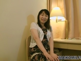 Lusty mature slut Tomoko Kubo is more than happy to try out her new sex toy