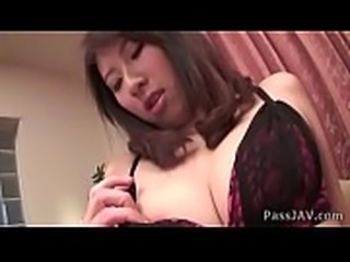Mai Asahina spread eagled on the couch her pussy toyed inside her red panties
