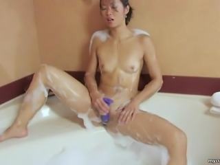 Horny Asian toys her shaved twat to orgasm while bathing