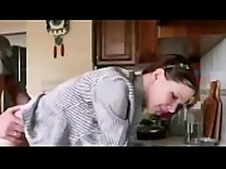 A talkative wife sucks cock and fucks in the kitchen