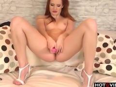 Redhead hottie enjoying her toys solo