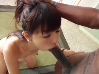 fashionable asian cowgirl in thong displaying her medium ass then giving huge dick blowjob