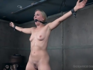 The master has unlucky Riley tied up in the dungeon and he is not going to let this sex slave go, until he gets his satisfaction. She has to take the pain, but soon it turns to pleasure, as he gags her and whips her.