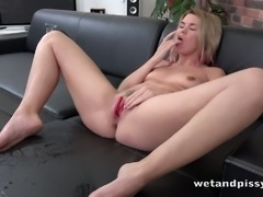 This blonde clearly loves peeing on the couch and she masturbates like a pro