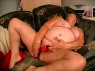 Chunky and busty white granny undresses and masturbates