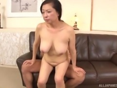 Mature Japanese woman spreads her legs for a hard cock