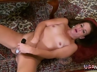 Sexy mature stripping down seductively and playing with adult toys