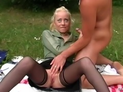 Dudes banging two slutty babes outdoors and pissing on them