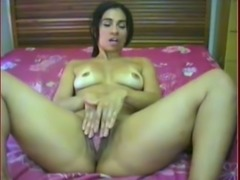 Naughty Latina hooker poking her butt hole with dildo