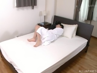 Cutie Yume Kana is completely naked and fingering her little cunt