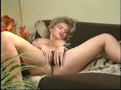This French blonde tickles her pussy with her vibrator on the couch