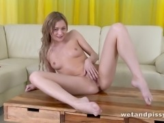 Kinky chick Olivia Devine loves to masturbate and piss at the same time