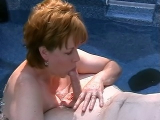 Horny mature slut is sucking my dick in the Jacuzzi