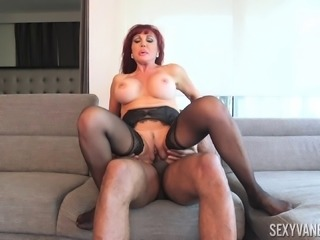 Redhead milf Sexy Vanessa removes her clothes to grab a black boner